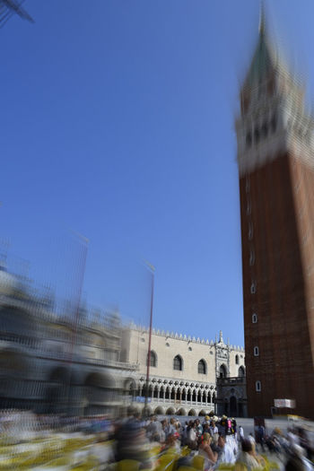 EyeEmNewHere IloveVenice Piazza San Marco Venezia Venice, Italy Architecture Blue Blurred Motion Building Exterior Built Structure City Clear Sky Crowd Day Ilovephotography Ilovetravelling  Large Group Of People Outdoors Sky Stmarcosquare Tourism Tower Travel Travel Destinations Venice