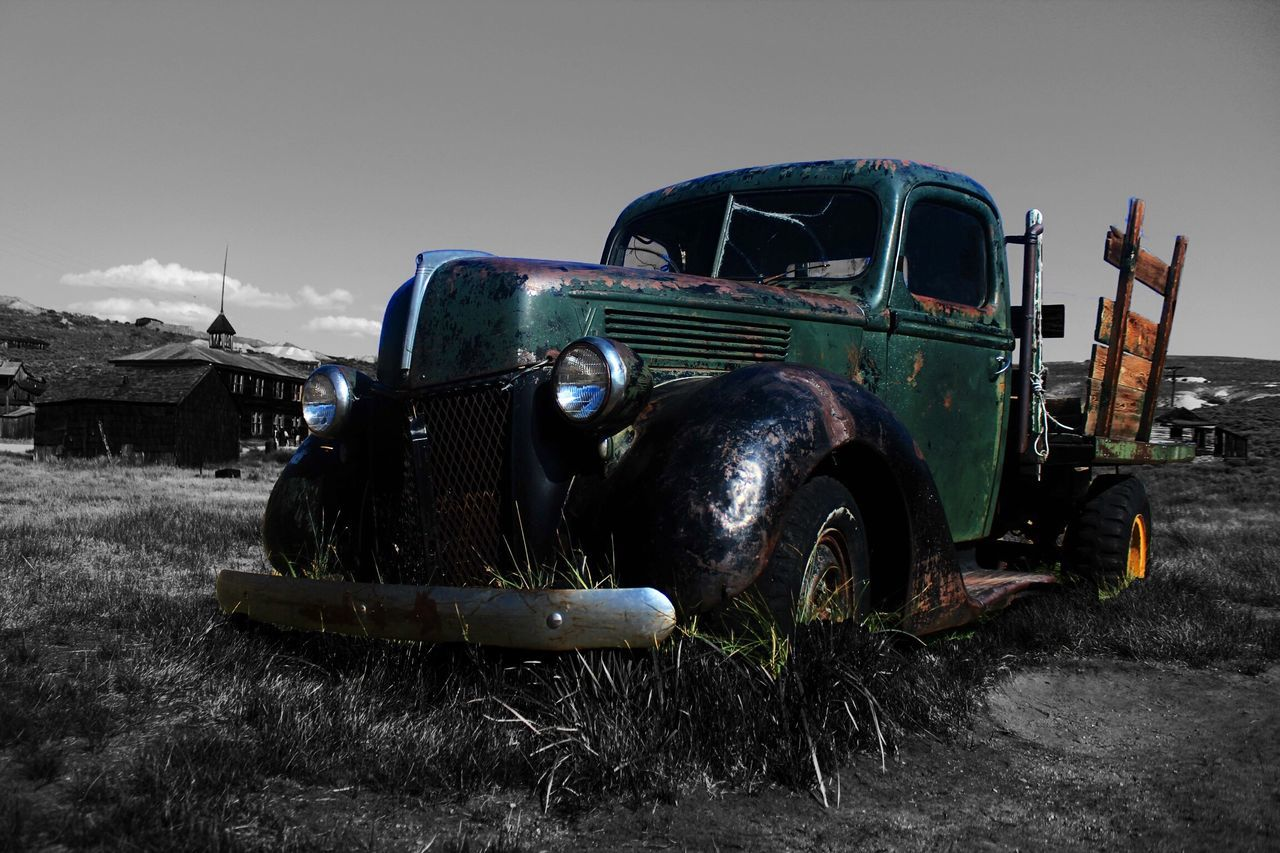 Abandoned Vintage Pick-Up Car On Field Against Sky
