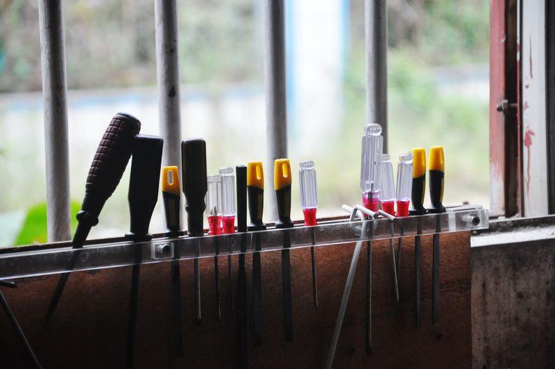 Various work tools against window at workshop