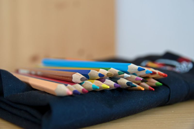 The Color Of School Indoors  Variation Still Life Close-up Large Group Of Objects Selective Focus Table Multi Colored Sewing Blue Sewing Item Choice In A Row Focus On Foreground Sewing Needle Group Of Objects Differential Focus Spool No People Variety