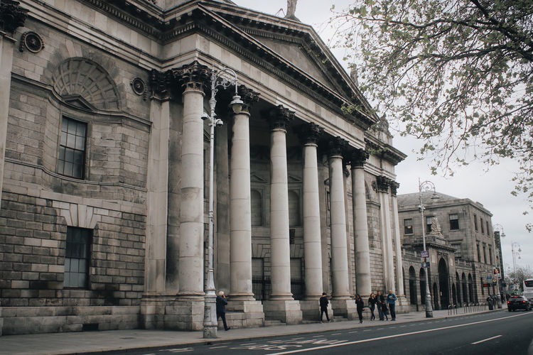 Architecture Building Exterior Built Structure Architectural Column History The Past City Tree Day Building Incidental People Travel Destinations Low Angle View Nature Real People Travel Outdoors Street Plant Group Of People Colonnade Dublin Irland Irish Travel Traveling Four Courts Court Courtyard  Old Old Buildings The Traveler - 2019 EyeEm Awards