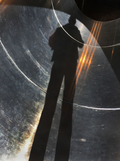 Shadow and light patterns on metal pipe Abstract Alone Person Photographer Pipe Reflection Shadow Shape