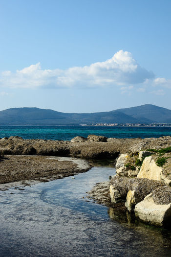 Alghero Beach Cloud - Sky Day Nature No People Outdoors Sardinia Scenics Sea Sea And Sky Seascape Sky Water