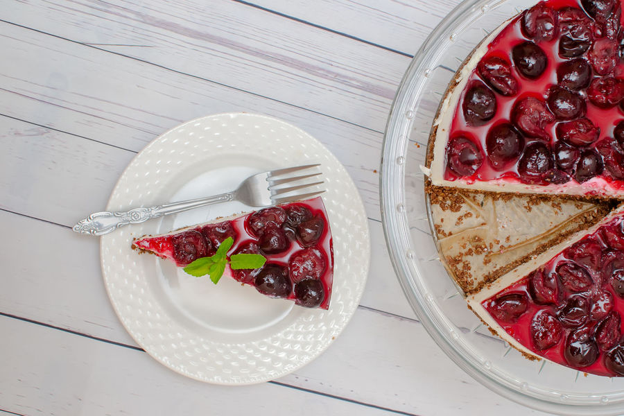 Cold cheesecake with cherry jelly on table Diet Berry Fruit Cake♥ Chery Chesecake Dessert Diabetic Food Directly Above Food Food And Drink Freshness Fruit Healthy Eating High Angle View Indoors  Indulgence No People Plate Ready-to-eat Red SLICE Still Life Sweet Food Table Temptation
