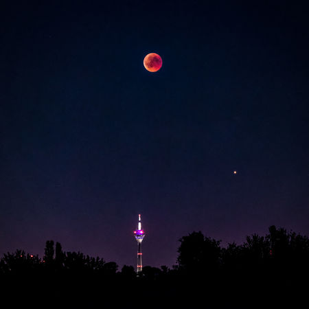 The Lunar eclipse over Düsseldorf. Düsseldorf EyeEm Best Shots EyeEm Nature Lover EyeEm Selects EyeEm Gallery Lunar Eclipse Architecture Astronomy Beauty In Nature Building Exterior Illuminated Moon Nature Night No People Rheinturm  Scenics - Nature Sky Space Stars Tree