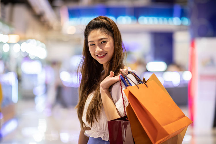 Beautiful Attractive Happy Asian Woman smile and enjoy with shopping bags in shopping mall,Shopping Concept Adult Asian  Attractive Background Bag Beautiful Beauty Buyer Buying Casual Charming Cheerful Chinese Colorful Customer  Cute Dress Enjoy Fashion Female Fun Girl Hand Happiness Happy Holding Joyful Lady Lifestyle Looking Mall Model People person Portrait Pretty Purchase Retail  Sale Shopaholic Shopper Shopping Shoulder Smile Store Summer White Woman Women Young