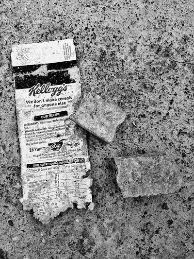 Kellogg's Cereal Black And White We don't make cereals for anyone else. Haha. Found this on the ground. The bricks haven't been staged either. Photooftheday Picoftheday Galaxys7 Streetphotography Scrap Old Worn Out