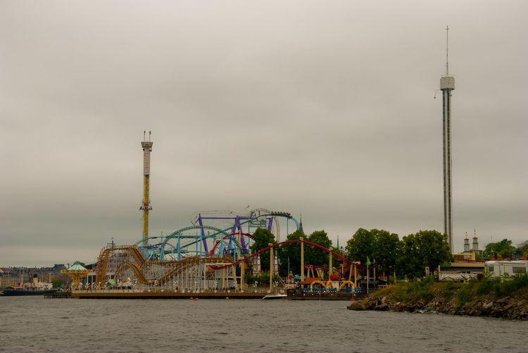 Ferris wheel at amusement park against sky