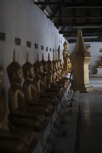 Statues in temple outside building