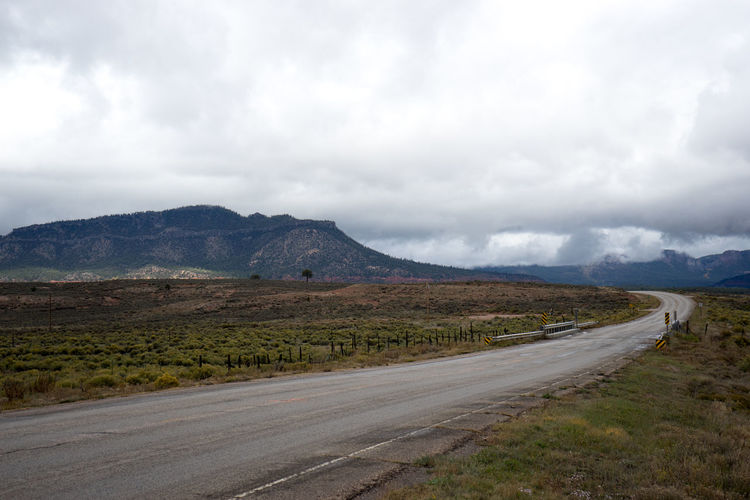 long road Road Transportation Cloud - Sky Landscape Mountain Sky Environment Nature No People Scenics - Nature Land Direction The Way Forward Highway Mountain Range Day Non-urban Scene Country Road Grass Tranquil Scene Outdoors Semi-arid