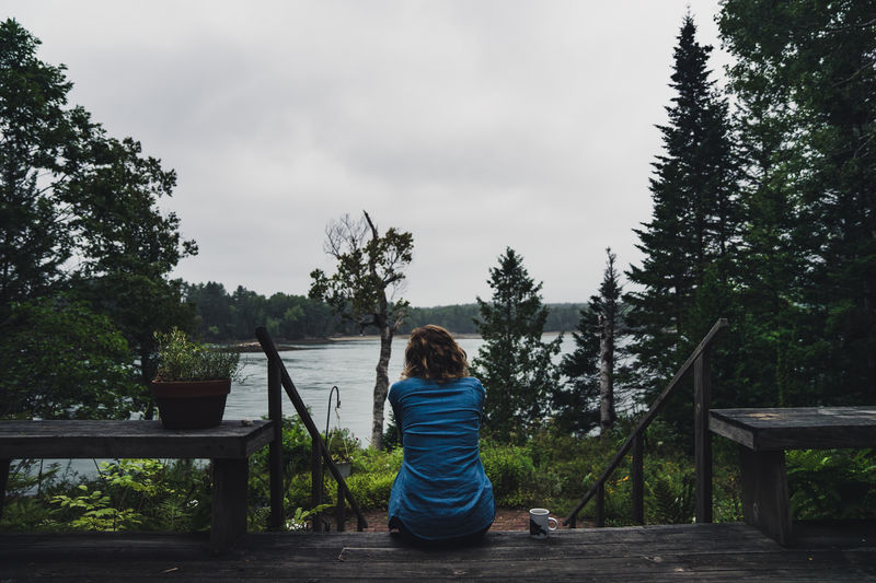 Bar Harbor Branch Casual Clothing Childhood Cloud Cloud - Sky Countryside Day Full Length Green Color In Front Of Innocence Leisure Activity Lifestyles Maine Outdoors Person Railing Rear View Relaxation Scenics Sky Solitude Tranquil Scene Tree