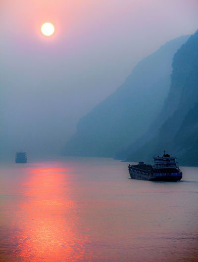 Sun Reflections On The Yangtze River Yangtze River Nautical Vessel Water Transportation Mode Of Transportation Beauty In Nature Ship Mountain Scenics - Nature No People Waterfront Nature Sky Tranquil Scene Sailing Tranquility Outdoors Passenger Craft Cruise Ship China Smog Sunrise Navigation Transportation Highway ASIA Air Quality Smoggy Reflections In The Water River Cliff Air Pollution Industrial