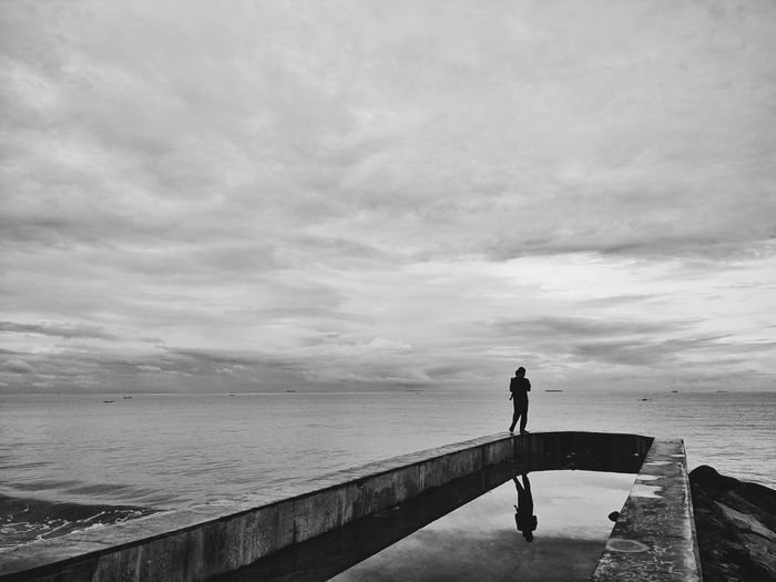 Mind of tranquility - Beach Sea Full Length Cloud - Sky One Person Water Standing Outdoors Tranquil Scene Eyeemindonesia horizon over water Tranquility Sand Day Silhouette Adult One Man Only People EyeEminPadang Perspectives On Nature Reflection The Week On EyeEm EyeEmNewHere EyeEm Gallery Postcode Postcards Be. Ready. Black And White Friday