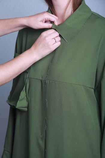 Cropped hands adjusting woman dress