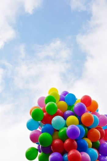 Low Angle View Of Colorful Balloons Against Sky