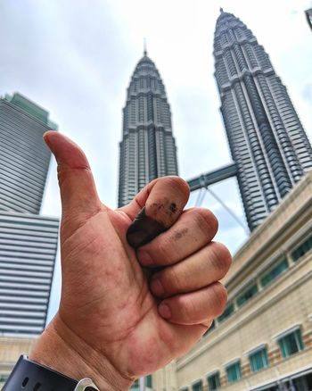 after the election Pru14 Malaysia Kuala Lumpur Malaysia  Malaysian Election EyeEm Selects Human Hand Politics And Government City Skyscraper Urban Skyline Government Politics Business Men Modern Office Building Tall - High Personal Perspective Building Exterior