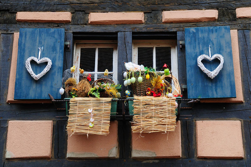 Easter decorations Easter Easter Ready France Window Decorations Architecture Building Exterior Built Structure Day Decoration Door Easter Decoration Flower Mammal Nature No People Outdoors Plant Window Box Wood - Material