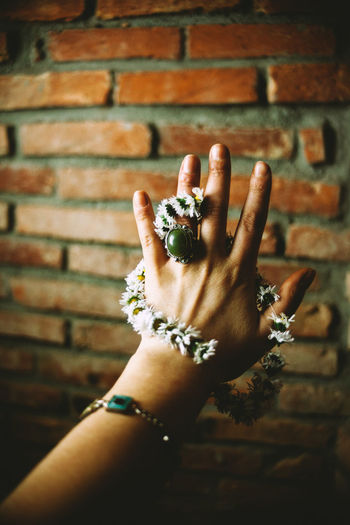 Brick Wall Close-up Daisy Day Focus On Foreground Holding Human Body Part Human Finger Human Hand One Person Outdoors People Real People Ring Spring
