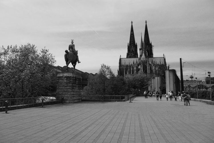 Black & White Cloudy Sky Cologne, Germany Köln Kölner Dom Architecture Art And Craft Black And White Building Exterior Built Structure City Cologne Cathedral Cologne Dom Human Representation Male Likeness People Sculpture Statue Travel Destinations Tree Stories From The City
