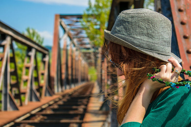 Young Woman By Railroad Tracks