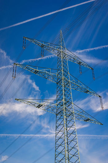 Power lines - blue sky Sky Low Angle View Cloud - Sky Blue Nature No People Day Fuel And Power Generation Technology Connection Metal Electricity  Power Supply Outdoors Cable Electricity Pylon Sunlight Tall - High Power Line  Industry Electrical Equipment Construction Equipment