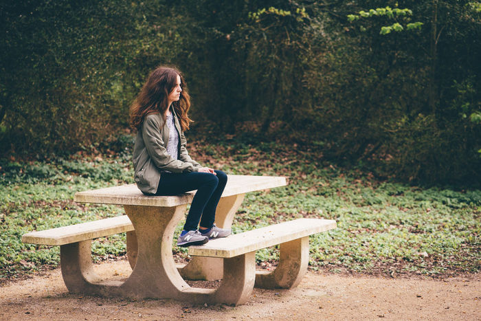 One Person Bench Casual Clothing Sitting Full Length Plant Day Seat Nature Leisure Activity Real People Tree Lifestyles Young Adult Looking Outdoors Park Side View Young Women Hairstyle Contemplation Park Bench Teenager Nostalgia Nostalgic  Pensive Thinking Posing Friend Personal Perspective