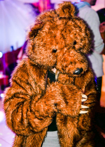 A person dancing in a costume bear coat. Cosplay Dancing Event Fun Funny Bear Coat Shar Pei Brown Costume Party Social Event