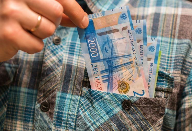 Midsection of man with money in pocket