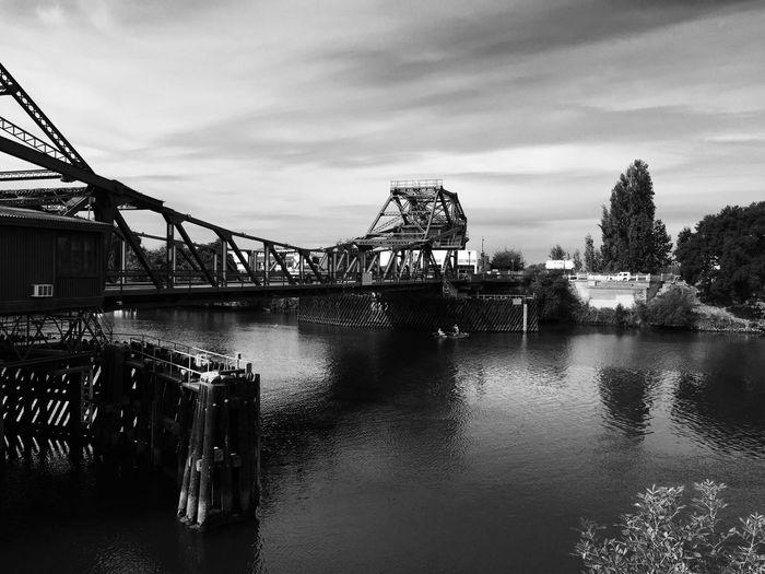 Drawbridge over sacramento river against sky