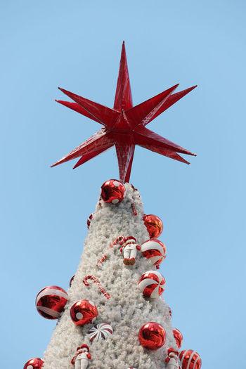 Blue Celebration Christmas Christmas Tree Clear Sky Day Low Angle View Red Sky Star Star Shape Tradition Tree Xmas