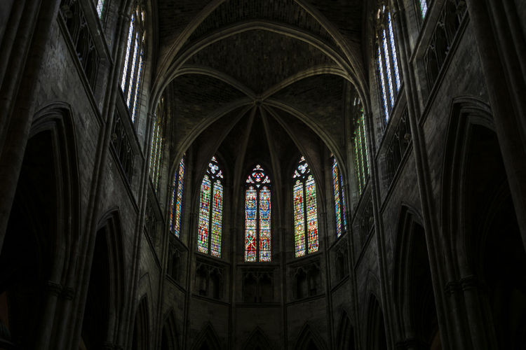Cathédrale Saint-André de Bordeaux Belief Religion Spirituality Stained Glass Place Of Worship Building Architecture Indoors  Glass Built Structure Window Arch Low Angle View Glass - Material No People Ceiling Architecture And Art Architectural Column Medieval Medieval Architecture Bordeaux Cathedral Travel Destinations Travel Light And Shadow darkness and light Exceptional Photographs Low Angle View The Architect - 2019 EyeEm Awards