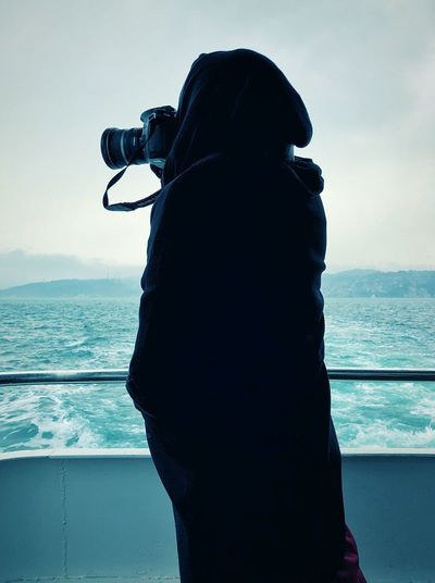 A woman with the camera Water Sea Silhouette Standing One Person Sky Real People Outdoors Leisure Activity Lifestyles Horizon Over Water Day Beauty In Nature Nature Scenics Photography Themes Adult One Woman Only The Traveler - 2018 EyeEm Awards International Women's Day 2019 My Best Photo