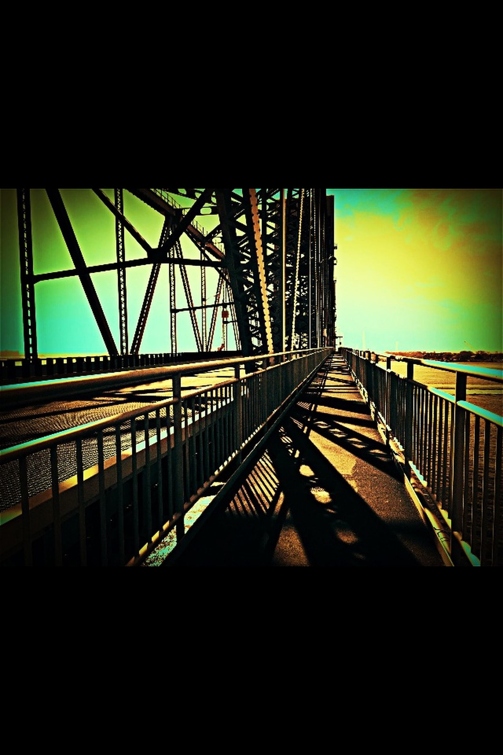 architecture, built structure, connection, bridge - man made structure, low angle view, sky, bridge, railing, engineering, transportation, building exterior, diminishing perspective, indoors, clear sky, no people, city, the way forward, long, metal
