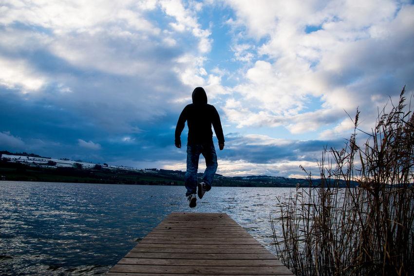Boardwalk Flying Levitation Men Outdoors Real People Reed Silhouette Sky Water
