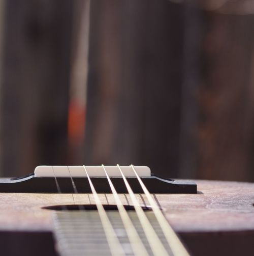 Guitar strings Musical Instrument Musical Equipment Music Arts Culture And Entertainment String Instrument Musical Instrument String Guitar String Close-up Selective Focus No People Wood - Material Acoustic Guitar Still Life