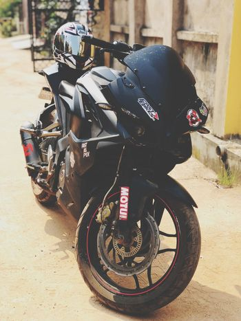The beautiful beast ❤️ Rs200 Bajaj Mode Of Transportation Land Vehicle Day Bicycle Stationary Sunlight Black Color Travel Helmet Motorcycle City Street Outdoors Parking Nature No People