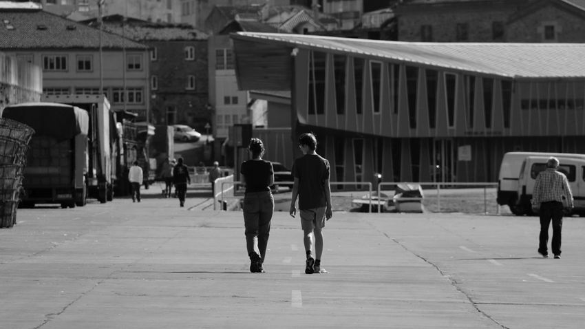 April 2014 Architecture Casual Clothing City Life Full Length Leisure Activity Lifestyles Men Narrow Perspective Real People Rear View Standing Street The Way Forward Urban Walking Wall Women
