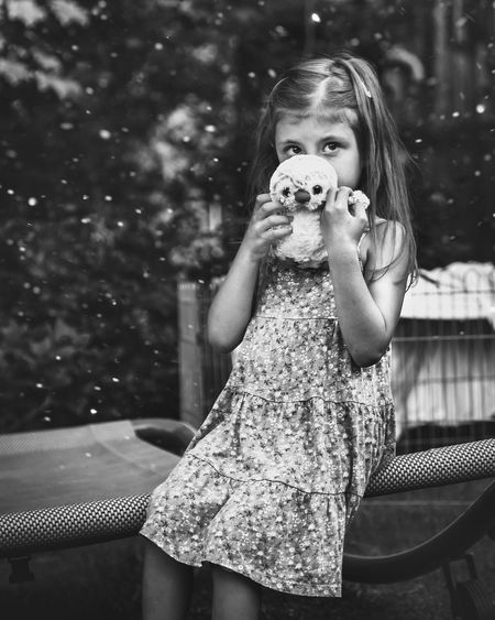 Blackandwhite Black And White Girl EyeEm Best Shots EyeEm Gallery EyeEmBestPics EyeEm Best Edits Girl Snapshot Outdoors Portrait Child Portrait Childhood Holding Backyard Posing