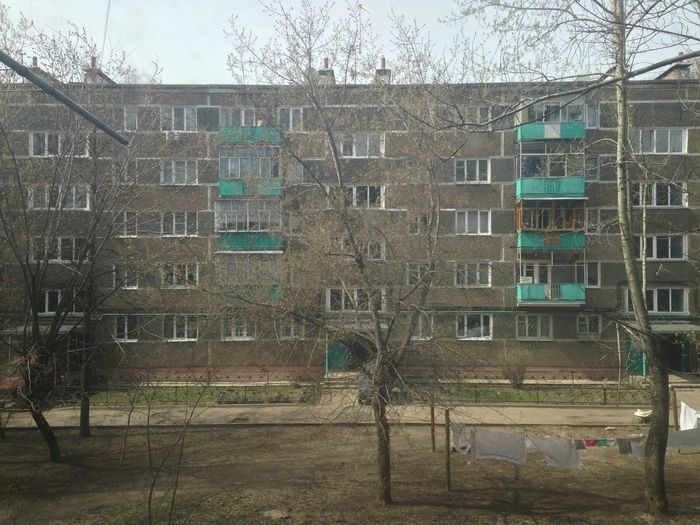 A very typical Khrushchyovka. Architecture Building Exterior Built Structure Day Khrushchevka Exterior Khrushchyovka Residential Building Residential Structure Tree