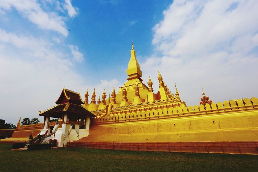Laos, Vientiane, Pha That Luang Buddhism Stupa Blue Sky Religion Built Structure Belief Architecture Cloud - Sky Place Of Worship Gold Colored No People