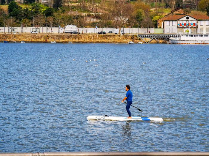 Full length of man on boat against sea