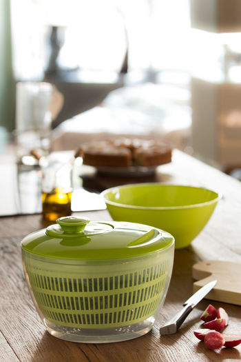 Preparing a salad Bowl Close-up Container Depth Of Field Focus On Foreground Food Green Color Healthy Eating Indoors  Kitchen Knife Olive Oil Preparation  Salad Salad Bowl Salad Spinner Still Life Studio Shot Table Tomatoes