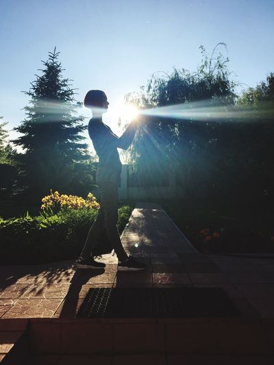 One Person Tree Sunlight Day Outdoors Silhouette Real People Shadow Standing Childhood Nature Clear Sky Sky Full Length Beauty In Nature Water People Beauty In Nature Light And Shadow Sunlight Human Hand Sun Sommergefühle
