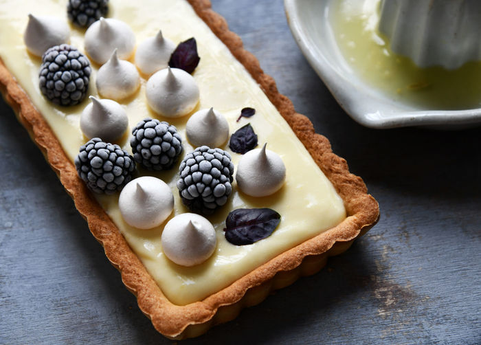 Close-up of a lemon cream pie with berries
