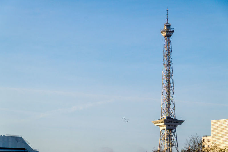Low angle view of television tower against sky