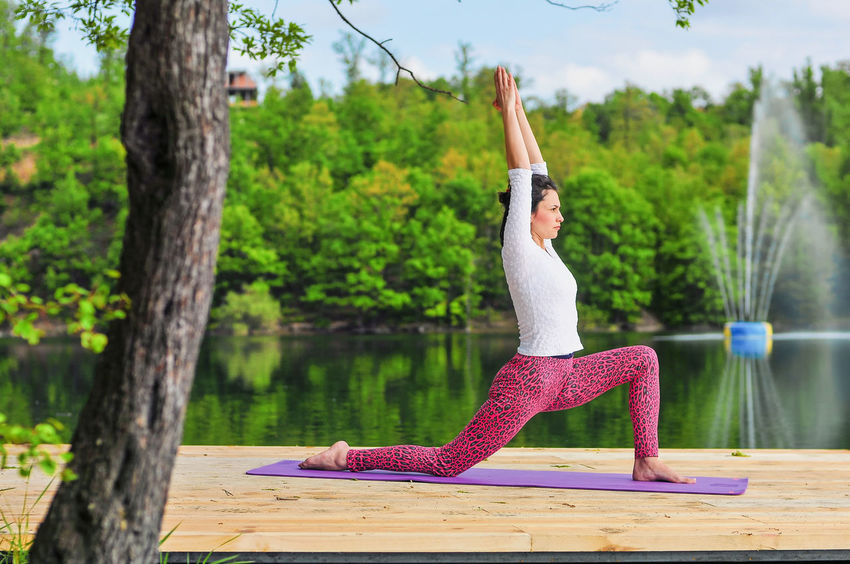 Yoga balancing over the beautiful lake. Balance Balance In Nature Beauty In Nature Exercising Exercising In Nature EyeEmNewHere Flexibility Forest In Background Healthy Lifestyle Lake Beauty Lifestyles Over The Lake Practicing Practicing Photography Relaxation Exercise Scents Sports Clothing Wellbeing Wooden Platform Yoga Yoga Mat Yoga Pose Anjaneyasana Yoga Pants