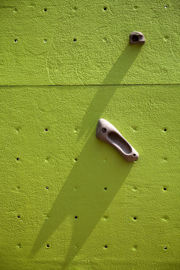 Handgrip of Climbing Wall Handgrip Architecture Backgrounds Building Exterior Built Structure Climbing Wall Close-up Day Full Frame Green Color Leaf Nature No People Outdoors Pattern Shadow Simplicity Sunlight Textured  Wall Wall - Building Feature