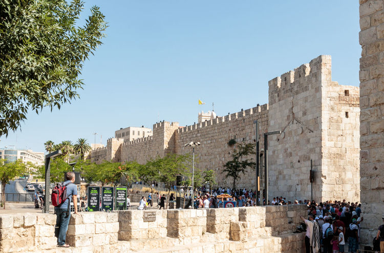 Jerusalem, Israel, July 14, 2016 : Fragment of the fortress walls of the old town and Jaffa Gate in Jerusalem Ancient Architecture Castle Citadel City Day East Famous Fortification Fortress History Holy Israel Jerusalem Jewish Old Protection Religion Sightseeing Sky Stone Tourism Tower Travel Wall