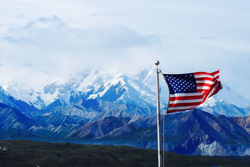 EyeEm Selects Flag Patriotism Mountain Mountain Range Landscape Nature Stars And Stripes Scenics Beauty In Nature Sky No People Blue Day Outdoors Snow Physical Geography