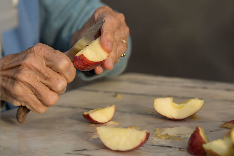 coring and slicing apples Apples Cored Edible  Elderly Hands Kazan Knife Preparation  Raw Slices Turkey Wrinkled Wrinkled Skin